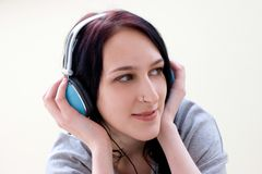 Caucasian dark haired woman with earphones Royalty Free Stock Image