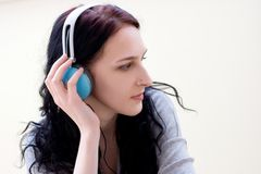 Caucasian dark haired woman with earphones Royalty Free Stock Photo