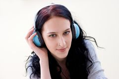 Caucasian dark haired woman with earphones Stock Image