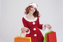 Caucasian de sorriso feliz Santa Girl em duas mentes com abundância de C Imagens de Stock Royalty Free