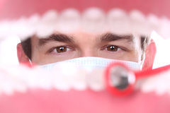 Caucasian Dentist Working Inside a Patient Mouth Stock Photos