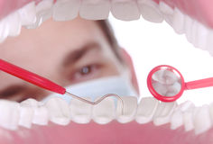 Caucasian Dentist Working Inside a Patient Mouth Stock Photo