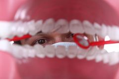 Caucasian Dentist Working Inside a Patient Mouth Stock Images