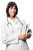 Caucasian Doctor with Books Royalty Free Stock Image