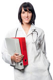 Caucasian Doctor with Folders Royalty Free Stock Photography