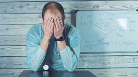 Caucasian doctor is giving bad news. Is shaking his head anxiously. stock footage