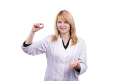 Caucasian doctor holding pills. Royalty Free Stock Photo