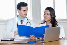 Caucasian doctor with nurse preparing for surgery. Indoors at office at hospital Royalty Free Stock Photo