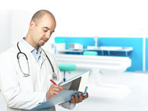 Caucasian doctor writing Stock Photography