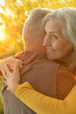 Caucasian elderly couple. Beautiful caucasian elderly couple in the park in autumn Royalty Free Stock Photography