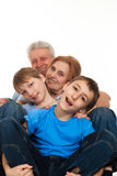 Caucasian elderly couple with their grandchildren. Happy luck Caucasian grandparents with grandchildren fooled on a light background royalty free stock images