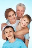 Caucasian elderly couple with their grandchildren Stock Photo