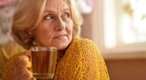 Caucasian elderly woman at home Royalty Free Stock Photos