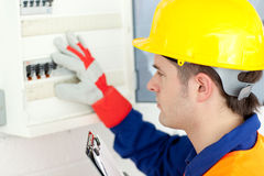 Caucasian electrician repairing a power plan Stock Photo