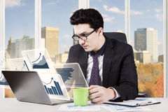 Caucasian entrepreneur with virtual chart Stock Photography