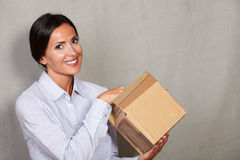 Caucasian ethnicity female opening a parcel Royalty Free Stock Images