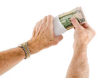 Caucasian ethnicity hands putting fifty dollar bills in envelope Stock Images