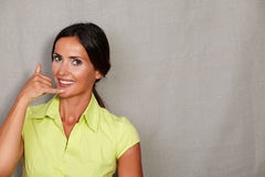 Caucasian ethnicity woman gesturing phone call Royalty Free Stock Photography