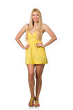 The caucasian fair model in yellow summer dress isolated on white. Caucasian fair model in yellow summer dress isolated on white royalty free stock photography