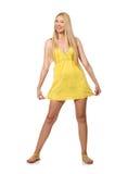 The caucasian fair model in yellow summer dress  on white Stock Image