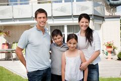 Caucasian family outside their new house Royalty Free Stock Image