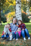 Caucasian family in park photographing on the cellphone. Selfie Royalty Free Stock Photo