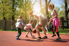Caucasian family playing basketball together. Happy family spending free time together Royalty Free Stock Image