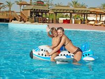Caucasian family at pool. Having fun in a pool Royalty Free Stock Image