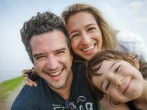 Caucasian family portrait selfie only son thirty year old parents only son child stock photo