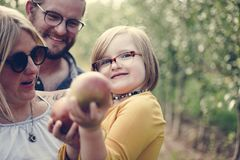 A Caucasian family is spending time at the farm together stock photography