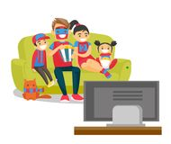 Caucasian family watching football match on TV. Young happy caucasian white family sitting on sofa, eating popcorn and watching football game together on Royalty Free Stock Image