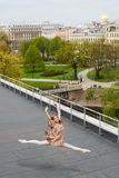 Caucasian fashion ballerina leaping on the roof Royalty Free Stock Photography