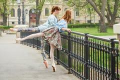 Caucasian fashion ballerina walking in the park royalty free stock image