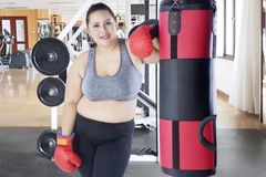 Caucasian fat woman leaning on a bag boxing royalty free stock photography