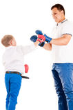 Caucasian father of boxing with son Royalty Free Stock Photography