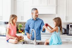 Free Caucasian Father Dad Gives Children Daughters Fresh Fruits To Eat Stock Image - 150551191