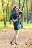 Caucasian Female Brunette Model Posing in Autumn Forest and smiling. Vertical Image Composition royalty free stock images