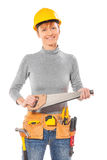 Caucasian female construction worker holding haandsaw looking at Royalty Free Stock Image