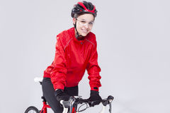 Caucasian Female Cyclist Equipped in Cycling Outfit and Posing With Road Bike Royalty Free Stock Photos