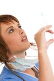 Caucasian female doctor holding syringe Royalty Free Stock Photo