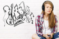Caucasian female listening to music Stock Photography