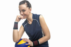 Caucasian Female Professional Volleyball Athlete Sitting and Hol Royalty Free Stock Photo