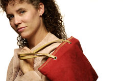 Caucasian female shopping. Beautiful caucasian female model carrying a red suede purse stock image