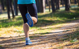 Caucasian female sport fitness model jogging. For marathon during outdoor workout Royalty Free Stock Photography