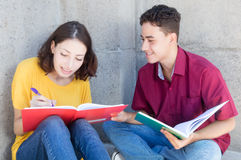 Caucasian female student learning with latin male student Stock Image
