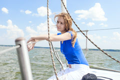 Caucasian Female Travelling Under Sale and Sitting on Handrails Stock Images