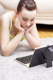 Caucasian Female Using Personal Tablet Computer With Keyboard. Stock Image