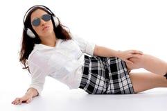 Caucasian female wearing headphones Stock Photography