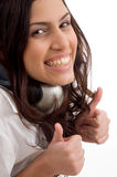 Caucasian female wearing headphones and thumbs up Royalty Free Stock Photography