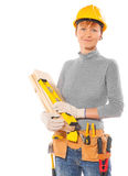 Caucasian female worker with construction tools holding wooden Stock Images